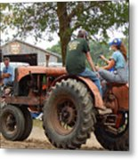 Girl Driving A Tractor Metal Print
