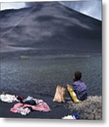 Girl Washing Clothes In A Lake With The Mount Yasur Volcano Emitting Smoke In The Background Metal Print by Sami Sarkis