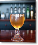 Goblet Of Refreshing Golden Beer On Shiny Dining Table Metal Print