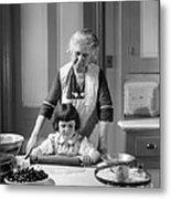 Grandmother And Granddaughter Baking Metal Print