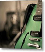 Green Electric Guitar With Blurry Background Metal Print