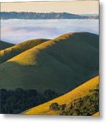 Green Hills And Low Clouds Metal Print