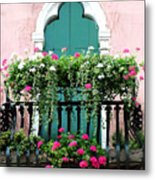 Green Ornate Door With Geraniums Metal Print