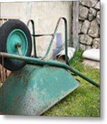 Green Wheelbarrow Lying On A Green Meadow Metal Print