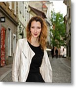 Grinning Attractive Woman Standing On Cobblestone Street Of Uppe Metal Print