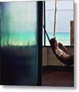 Guy With The Hat Lying In A Hammock On The Porch Of The Old House And Relaxing By The Caribbean Sea Metal Print