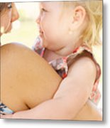Happy Mother Holding Baby With Look Of Surprise Metal Print
