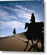 Horseback Riders In Silhouette On Sand Metal Print