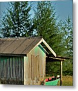 Hut With Green Boat Metal Print