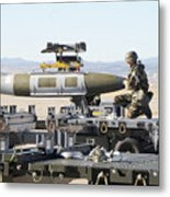 Irman Assists In Lowering A Guided Bomb Metal Print