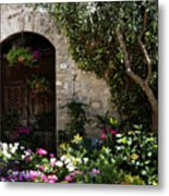 Italian Front Door Adorned With Flowers Metal Print