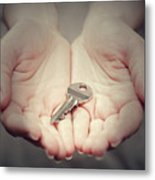 Key In Woman's Hand In Gesture Of Giving. Concept Of Success In Live, Business Solution, Real Estate Etc Metal Print