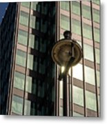 Lamp Post Against Green Glass Building Metal Print