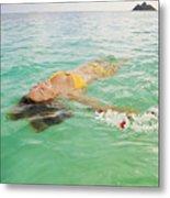 Lanikai Floating Woman Metal Print by Tomas del Amo - Printscapes