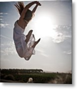 Leaping For The Sun Metal Print