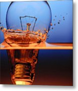 Light Bulb And Splash Water Metal Print by Setsiri Silapasuwanchai