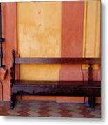 Long Wooden Bench Against A Yellow Wall At The Alcazar Of Seville Metal Print