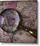 Magnifying  Glass On Old Map Metal Print