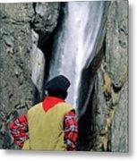 Man Facing A Waterfall Metal Print