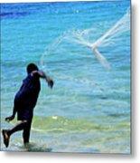 Man Launching His Fishing Net Into The Crystal Water Metal Print