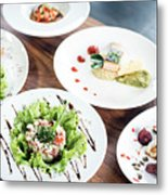 Mixed Modern Gourmet Fusion Food Dishes On Table Metal Print