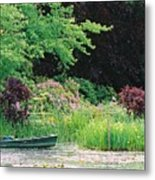 Monet's Garden Pond And Boat Metal Print