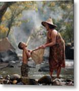 Mother And Son Are Happy With The Fish In The Natural Water Metal Print
