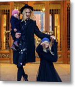 Mother With Two Daughters Standing Next To The Store In The Evening On The Street Metal Print