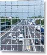 Narrow Depth Of Field Looking Down From Railing Onto Busy Highway Metal Print