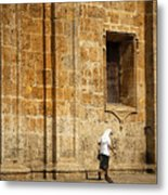 Nun Walking In Front Of Cathedral Metal Print