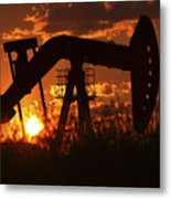 Oil Rig Pump Jack Silhouetted By Setting Sun Metal Print