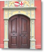 Old Door And Emblem Metal Print