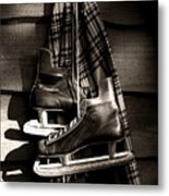Old Hockey Skates With Scarf Hanging On A Wall Metal Print