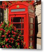 Old Red Telephone Box Or Booth Surrounded By Red Flowers In Toro Metal Print