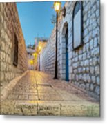 Old Stone Alleyway With Electric Lights Metal Print by Noam Armonn
