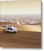 One 4x4 Vehicle Off-roading In The Red Sand Dunes Of Dubai Emirates, United Arab Emirates Metal Print