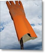 Orange Rubber Glove On A Wooden Post Against A Cloudy Sky Metal Print