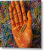 Orange Wooden Hand Holding Paperclips Metal Print