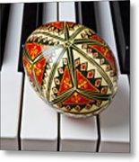Painted Easter Egg On Piano Keys Metal Print