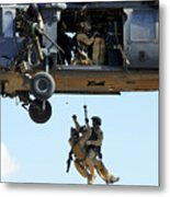 Pararescuemen Are Hoisted Into An Hh-60 Metal Print