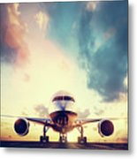 Passenger Airplane Taking Off On Runway At Sunset Metal Print