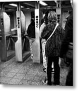 passengers moving through exit turnstiles in subway station New York City USA Metal Print
