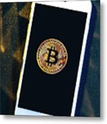 Phone With A Bitcoin Laying On Top Of It. Metal Print