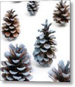 Pine Cones Looking Like Christmas Trees On White Snowy Backgroun Metal Print