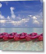 Pink Kayaks Lined Up Metal Print