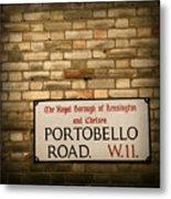 Portobello Road Sign On A Grunge Brick Wall In London England Metal Print