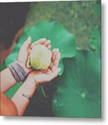 Portrait Of A Girl Holding Gently A Lotus Flower In Her Hands Metal Print