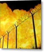 Realistic Orange Fire Explosion Behind Restricted Area Barbed Wire Fence, Blurred Background Metal Print