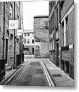 red brick buildings in narrow back turner street Northern quarter Manchester uk Metal Print
