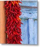 Red Peppers And Blue Door Metal Print